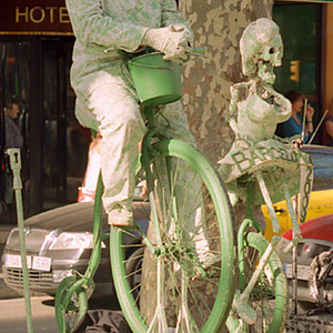 Green Cyclist | Leica Elmar 90mm f/4 collapsible <br> Click image for more details, Click <b>X</b> on top right of image to close