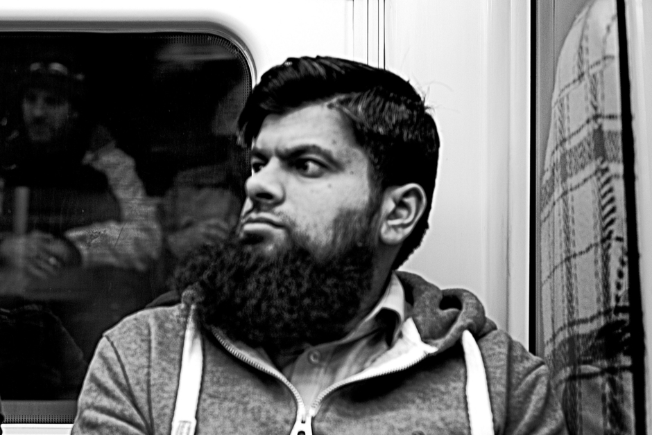 Jubilee Line Fellow Passenger | Zeiss ZM C Sonnar T* f1.5 50mm <br> Click image for more details, Click <b>X</b> on top right of image to close